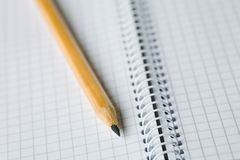 Empty notebook and pencil. A photo of a pencil on the spiral notebook Royalty Free Stock Photography