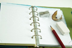 Empty notebook with pencil and eraser Stock Photos