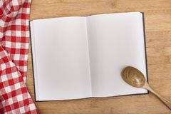Empty notebook for recipes with spoon and. Empty notebook note book recipes table background Royalty Free Stock Image
