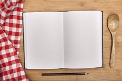 Empty notebook for recipes with spoon on wooden. Empty notebook note book recipes table background Royalty Free Stock Photos