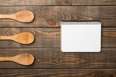 Empty notebook for recipes with spoons on wooden. Empty notebook note book recipes table background Stock Photos