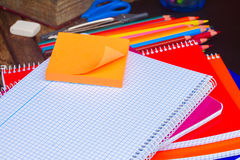 Empty notebook and set of colorful pencils on stock photography