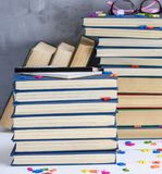 Empty notebook with white sheets and many different books royalty free stock photo