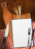 Empty Notebook on Wooden Cutting Board Stock Photography
