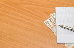 Empty notepad with euro banknote, pen Stock Photos