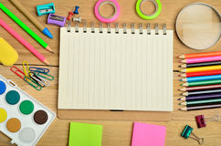 Empty notepad with office school. On wooden table Royalty Free Stock Photo