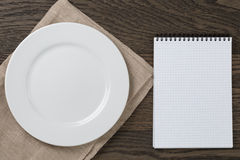 Empty notepad for pecepie on oak table Royalty Free Stock Photo