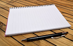 Empty notepad with pen Stock Images
