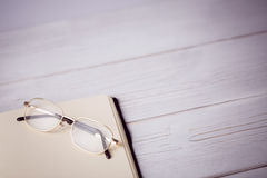 Empty notepad with reading glasses stock photo