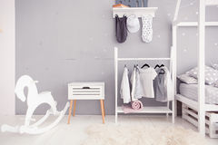 Empty nursery room with clear wall, toys and wooden horse Stock Photography