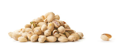 Empty Nutshell beside Pistachios Stock Photo