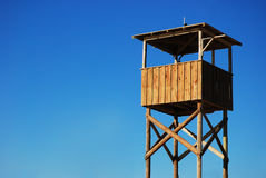 Empty Observing Stand On Beach. Wooden stand against blue sky Stock Image