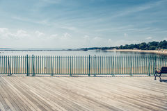 Empty ocean beach boardwalk pier at hot summer day against blue sky Royalty Free Stock Photography