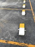 Empty of car parking area made line symbol yellow on dry concrete floor on parking area. stock photos