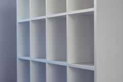 Empty office or bookcase library shelves Stock Image