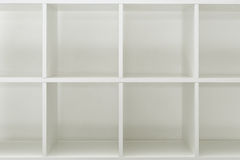 Empty office or bookcase library shelves. With blank copy space for design mock up or product placement Royalty Free Stock Photos