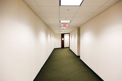 Empty office building hallway Stock Images