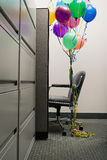 Empty office chair with balloons tied to it Royalty Free Stock Images