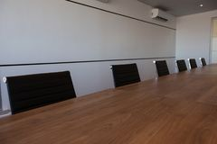 Empty office chairs at conference table Stock Photography