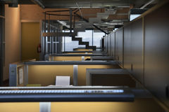 Empty office cubicles. Row of empty office cubicles in an industrial style office space Stock Photos