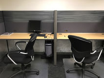 Empty Office Cubicles. Two empty office cubicles with chairs Royalty Free Stock Image