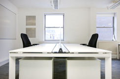 Empty office desks back to back Stock Images