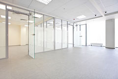 Empty office hall. With glass walls and doors Royalty Free Stock Photos
