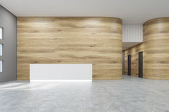 Empty office hall with wooden and gray walls and concrete floor. Royalty Free Stock Photos