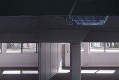 Empty office interior blue tones. Elevated view of the darkly empty office interior royalty free stock photo
