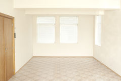 Empty office room with wooden door Stock Images