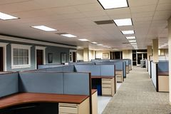 Empty Office Space Ready to Occupy. This image depicts an empty office ready for occupation by a workforce or company.  It is a typical cubicle environment with Royalty Free Stock Photos