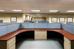 Empty Office Space Ready to Occupy. This image depicts an empty office ready for occupation by a workforce or company.  It is a typical cubicle environment with Stock Images
