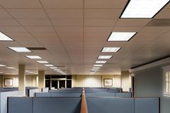 Empty Office Space Ready to Occupy. This image depicts an empty office ready for occupation by a workforce or company.  It is a typical cubicle environment with Stock Photo