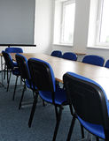 Empty office with table and chairs. Empty office with long table and blue chairs stock images