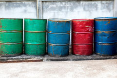 Empty oil barrels, rusty and weathered Stock Images