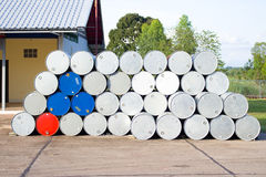 Empty oil gallons in a gas station. Gallon stack royalty free stock photography