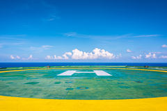 Empty oil rig helipad with few cloud and blue sky Royalty Free Stock Images