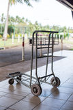 Old airport luggage cart Stock Images