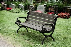 Empty old bench in cemetery Royalty Free Stock Image
