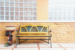 Empty Old Bench. Empty Rustic wooden outdoor cottage bench painted white against wall royalty free stock photography