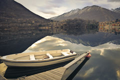 Empty old boat anchored Stock Photo