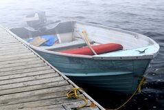 Boat in fog Stock Images