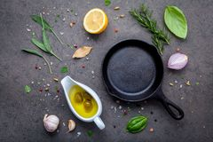 Empty old cast iron skille on dark stone background. Ingredients Stock Images