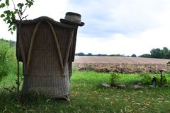 Empty old chair stands with a view of the field royalty free stock image