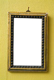 Empty old frame. Hanged on a retro green wallpaper Royalty Free Stock Image