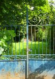 Empty old house, locked gate stock photography