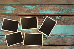 Empty old instant paper photo album on wood table Stock Photos