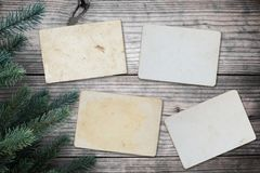 Empty old instant photos paper on wood table in christmas. Stock Image