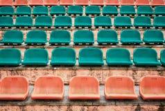Empty old plastic seats at stadium, open door arena. Royalty Free Stock Photos