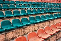 Empty old plastic seats at stadium, open door arena. Stock Photography